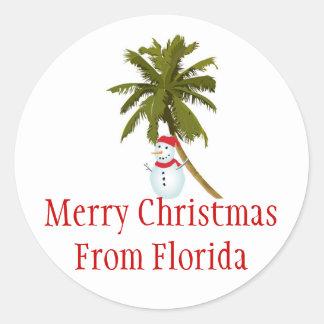 Merry Florida Christmas, snowman under palm tree Round Sticker