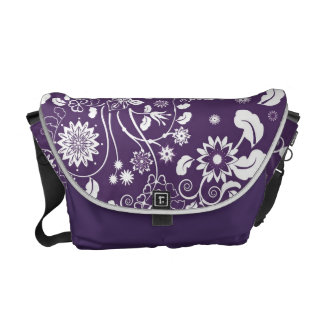 Messenger bag with white decorative flowers