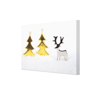 Metal Christmas tree and reindeer in the snow Stretched Canvas Print