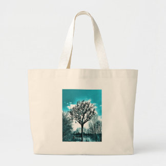 metal tree on the field large tote bag