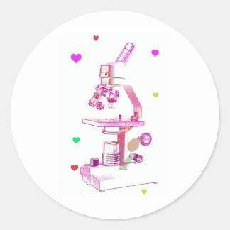 microscope in pink round sticker
