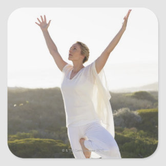 Mid adult woman practicing yoga 2 square sticker