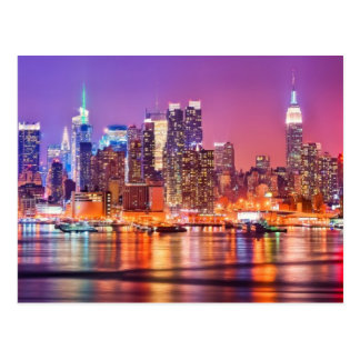 Midtown Manhattan at night with Empire Stae Postcard