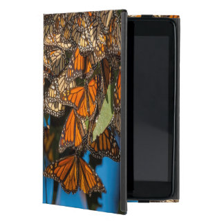 Migrating monarch butterflies cling to leaves iPad mini cover