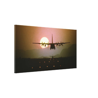 Military plane at sunset canvas print