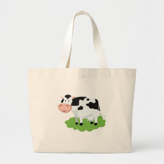 milking cow in the garden large tote bag