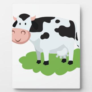 milking cow in the garden plaque