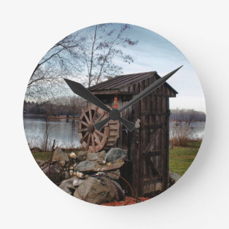 Milling about the old outhouse round clock