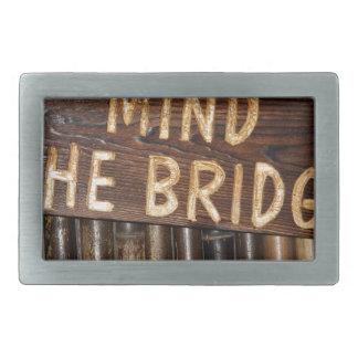 Mind the Bridge wooden sign Belt Buckle