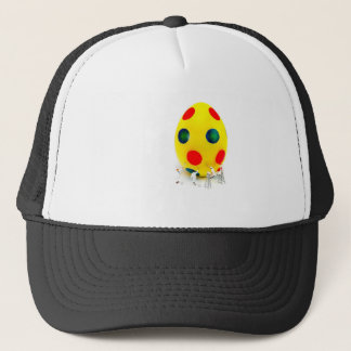 Miniature figurines painting yellow easter egg trucker hat