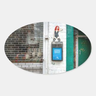 Minicab graffiti girl oval sticker