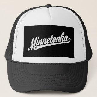 Minnetonka script logo in white distressed trucker hat