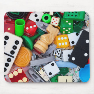 Miscellaneous game pieces on a mouse pad
