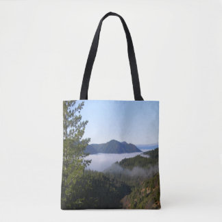 Misting fog in the mountains.. tote bag