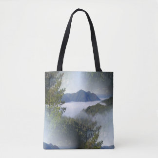 Misting fog over the mountains... tote bag