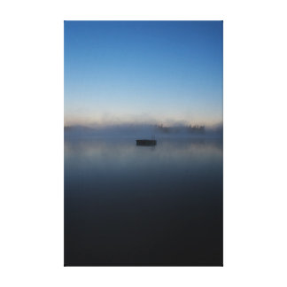 Misty morning floating dock on lake with blue sky canvas print