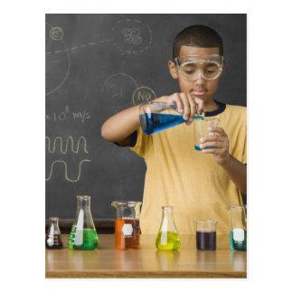 Mixed Race boy in science class Postcard