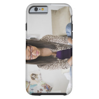 Mixed race teenage girl doing homework on bed tough iPhone 6 case