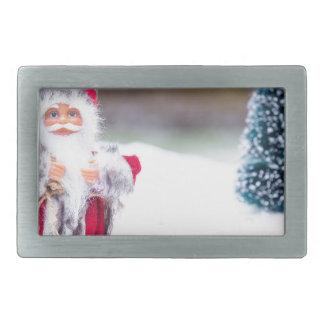 Model of Santa Claus standing in white snow Belt Buckles