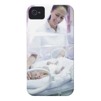 MODEL RELEASED. Nurse and premature baby. Case-Mate iPhone 4 Cases