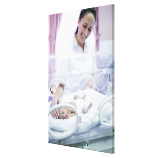 MODEL RELEASED. Nurse and premature baby. Gallery Wrap Canvas