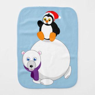 Modern cartoon of a penguin riding a polar bear, burp cloth