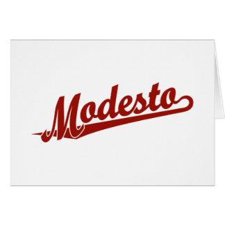 Modesto script logo in red card