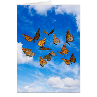 Monarch butterflies in the sky greeting card
