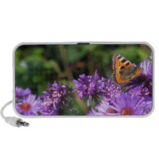 Monarch butterfly and purple flowers travelling speaker