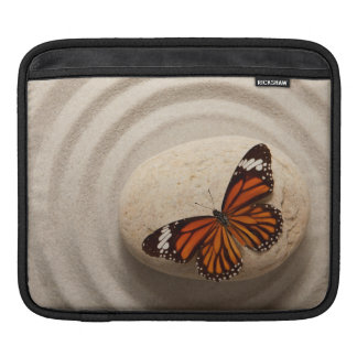 Monarch Butterfly on a Stone in a Zen Garden iPad Sleeve