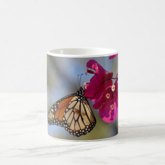 Monarch butterfly on bougainvillea coffee mug
