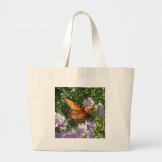 Monarch Butterfly Resting on a Flower Canvas Bags