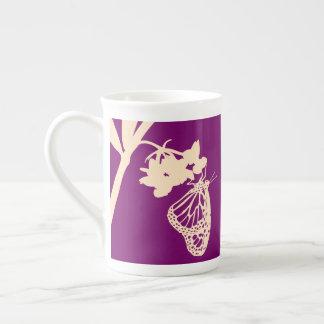 Monarch Butterfly Silhouette against Purple Tea Cup