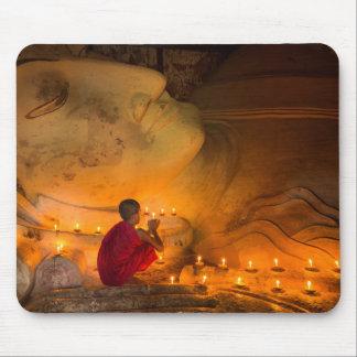 Monk Praying By A Buddha Mouse Pad