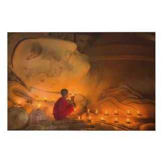 Monk Praying By A Buddha Wood Wall Art