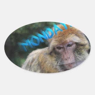 Monkey sad about monday oval sticker