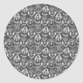 monochrome singing angels on gray background round sticker