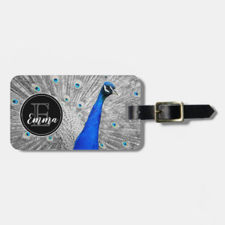 Monogram and photograph of white peacock feathers, luggage tag