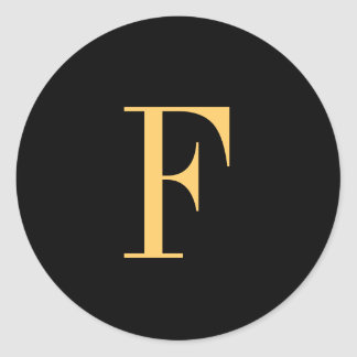 Monogram F gold-colored on black background Classic Round Sticker