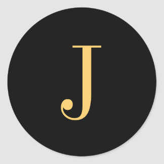 Monogram J gold-colored on black background Classic Round Sticker