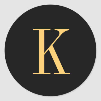 Monogram K gold-colored on black background Classic Round Sticker