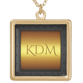 Monogram on brass with riveted steel frame gold plated necklace