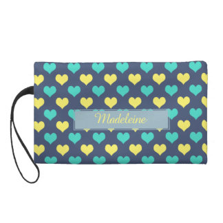 Monogram Wristle Bag with patterns of hearts