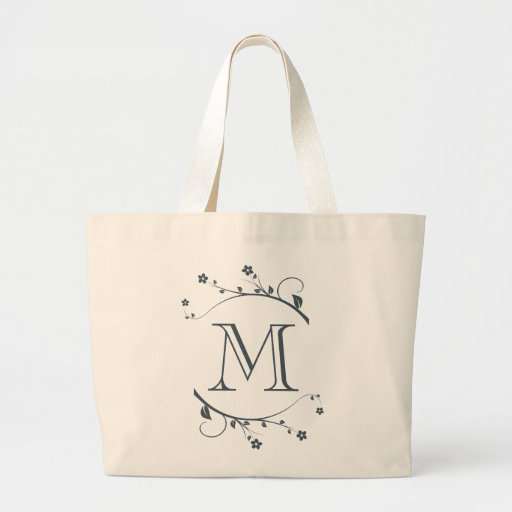 Monograma and adornment of branches spring in bags