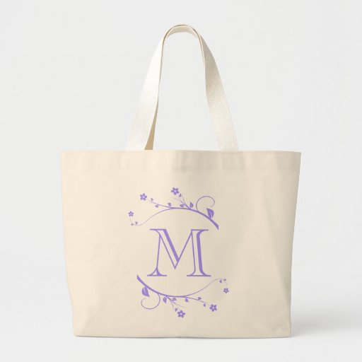 Monograma and adornment of violet spring in canvas bag