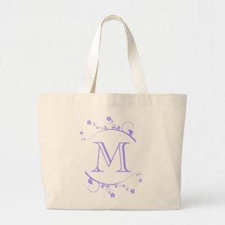 Monograma y adorno de primavera violeta en bolsa lienzo