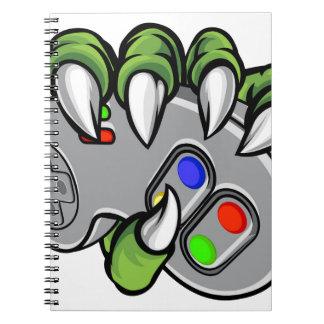 Monster Hand Holding Video Games Controller Spiral Notebook