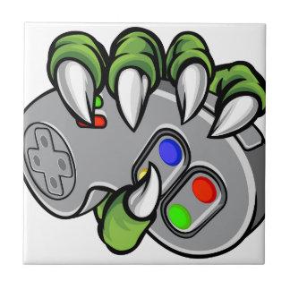 Monster Hand Holding Video Games Controller Tile