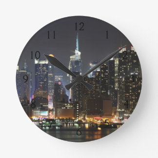 Moon rises over midtown New York. Round Clock