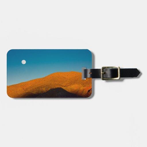 Moonrise over Mojave desert Travel Bag Tags